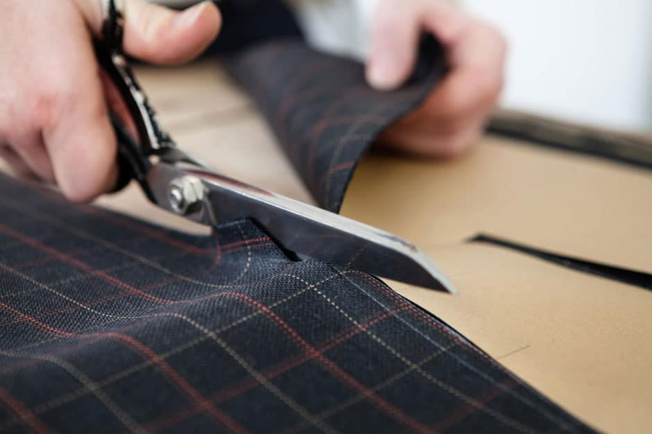 Cutting the cloth to the paper pattern at Egon Brandstetter Bespoke Tailor Berlin