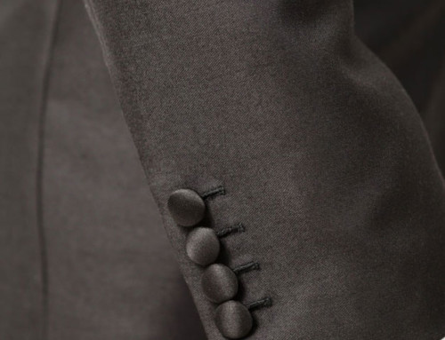 Fabric–covered sleeve buttons of a bespoke dinner jacket