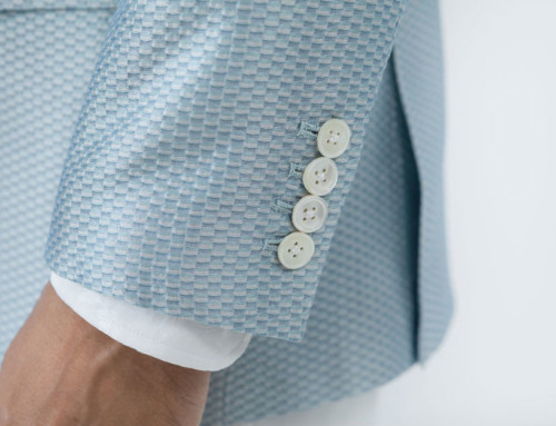 Sleeve buttons on a silk–piqué jacket