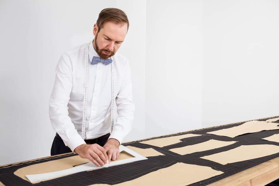 Bespoke tailor Egon Brandstetter constructing the pattern of a custom-tailored suit at his workshop in Berlin